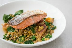Seared Salmon with Green Lentils, Roasted Beets, Wilted Kale and Sauce Vierge